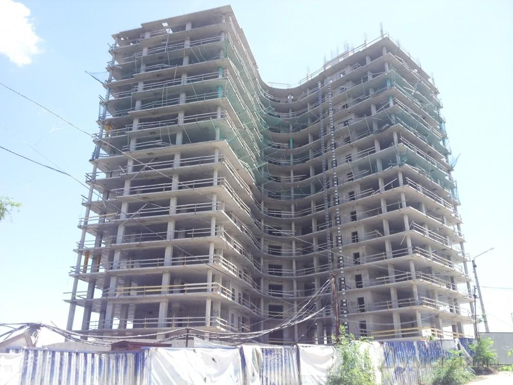 Стоит ли покупать квартиру в строящемся доме?