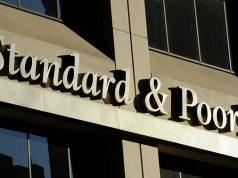 """S&P изменило прогноз по долгосрочным рейтингам Бинбанка на """"развивающийся"""""""