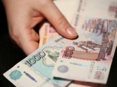 Россияне отдают по кредитам 32 процента своего дохода